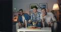 Joyful guys eating snacks watching funny show on TV laughing at night at home 56726220