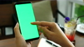 woman hand holding smart phone with green screen 56735704