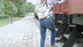 Asian tourist woman at railway station 56736232