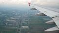 aerial view through an airplane window at landing  56736441