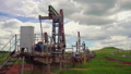 The overground drive for a reciprocating piston pump in an oil well. overall plan 56745398