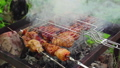 grilling meat on coals in a garbage can, close-up 56745399