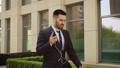 Happy Successful Businessman Dancing In Wireless Earphones 56747828