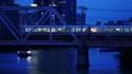 大阪環状線 淀川橋梁を渡るJR車両と大川を進む観光船 56795409