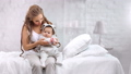 Domestic happy woman and cute baby rejoicing morning playing at white room interior background 56816143