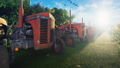 Old tractors stand near a corn field early in the morning. Agriculture and environment. 56848113