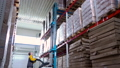 warehouse worker driver in uniform delivery and loading cardboxes by forklift stacker loader 56856877