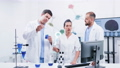 Group of three scientists in modern laboratory 56882950