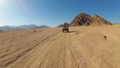 Sexy Woman is Riding a Quad Bike in the Desert of Egypt. Dynamic view in motion. 56915253