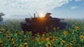 Military tank at sunset on a field in the middle of sunflowers. 56922432