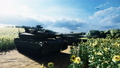 Military tanks on a clear Sunny summer day on a field in the middle of sunflowers. 56950804