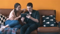 Close-up view of happy young couple sitting on the couch at home and watching to tablet screen 56959384