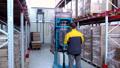 warehouse worker driver in uniform loading cardboard boxes by forklift stacker loader 56959773