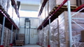 Rows of shelves with boxes in modern warehouse 56959774