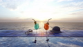 Beautiful glasses with cocktails on the background of the sea and the sunrise. 56961154