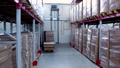 Rows of shelves with boxes in modern warehouse 56974489