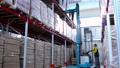 warehouse worker driver in uniform loading cardboard boxes by forklift stacker loader 56974491