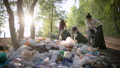 Women volunteers liquidate a large landfill. Illegal landfill in the forest spoils nature and 57025061