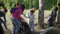 A group of women and children collect garbage in the forest. Volunteers collect plastic and other 57025440