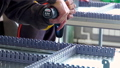 Drill screwdriver workflow creation of metal parts. male metal worker using drillpress. Close up 57039848