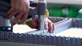 Drill screwdriver workflow creation of metal parts. male metal worker using drillpress. Close up 57040037