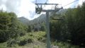 Aerial view on ropeway. Chairlift in forest. Movement on Cableway in summer through the forest 57060763