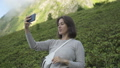 Young Blogger Woman Recording Selfie Video While Hiking on Top of Mountain. Lifestyle Travel Vlog 57064994