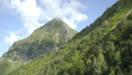 Aerial view of mountains with green forest, trees in summer day. Slopes of mountains with coniferous 57064998