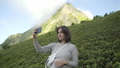 Woman taking selfies in the heart of the Caucasus Mountains. Freedom and adventure concept. 57065000