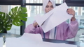 Small business and hobby concept. Muslim woman fashion designer pinning paper pattern at the table 57065339