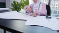 Small business and hobby concept. Muslim woman fashion designer pinning paper pattern at the table 57065389