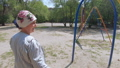 Grandmother with a grandson on a swing 57134777
