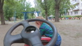 Boy with a toy steering wheel 57151131