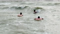 People in inflatable circles swim on the waves in the sea 57197542