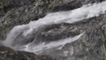 Slow motion shot of waterfall flowing down the rock. Horizontal video 57201193