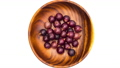 Put grapes into wooden plate on white background 57434261