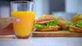 Pouring orange juice with sandwich for breakfast 57582649