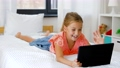 girl having vide call on tablet computer at home 57625095