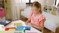 creative girl making greeting card at home 57625097