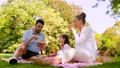 family eating sandwiches on picnic at summer park 57625106