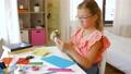 creative girl making greeting card at home 57625111