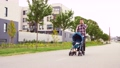 father with stroller calling on smartphone in city 57625639