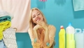Cheerful blonde housemaid is rejoicing at good qualified detergent 57783622