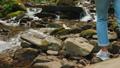 Female legs crossing mountain river 57783741