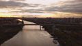 Aerial panoramic view of a river and a bridge over it at dramatic colorful sunset 58013871