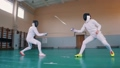 Two young women having a fencing training 58288727