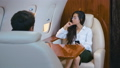 Beautiful successful business woman travels on a private plane. Business trip. Classically dressed 58418404
