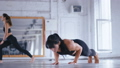 Athletic Beautiful Woman Doing Push-ups on the floor in Cross Fitness Gym. Sportswoman Exercising in 58418408
