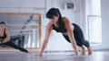 Athletic Beautiful Woman Doing Push-ups on the floor in Cross Fitness Gym. Sportswoman Exercising in 58418417
