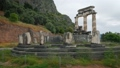 Tholos with Doric columns at the Athena Pronoia temple ruins in Delphi, Greece 58465009